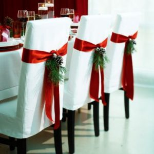 Dining chairs decked out for the holidays. More in this series.