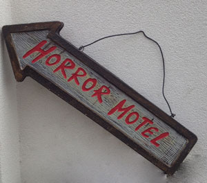 HORROR MOTEL ARROW SIGN