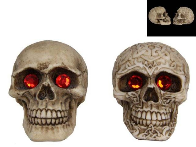 REALISTIC SKULL WITH RED RUBY GEMSTONE EYES
